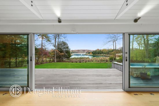 For sale: $2,300,000. Clean lines inside flow to the amazing grounds and waterside pool.   Showroom finishes adorn this waterfront cottage on Three Mile Harbor. Walls of glass overlooking the harvor and an open floor plan with high end touches make this the perfect Hamptons beach house. Fleetwood floor to ceiling sliders, Wolf Range, Sub Zero fridge, Wolf wine fridge, Miele Washer and Dryer, Calazzo outdoor shower, luxurious master with steam shower.  Waterside pool with large lawns in the…