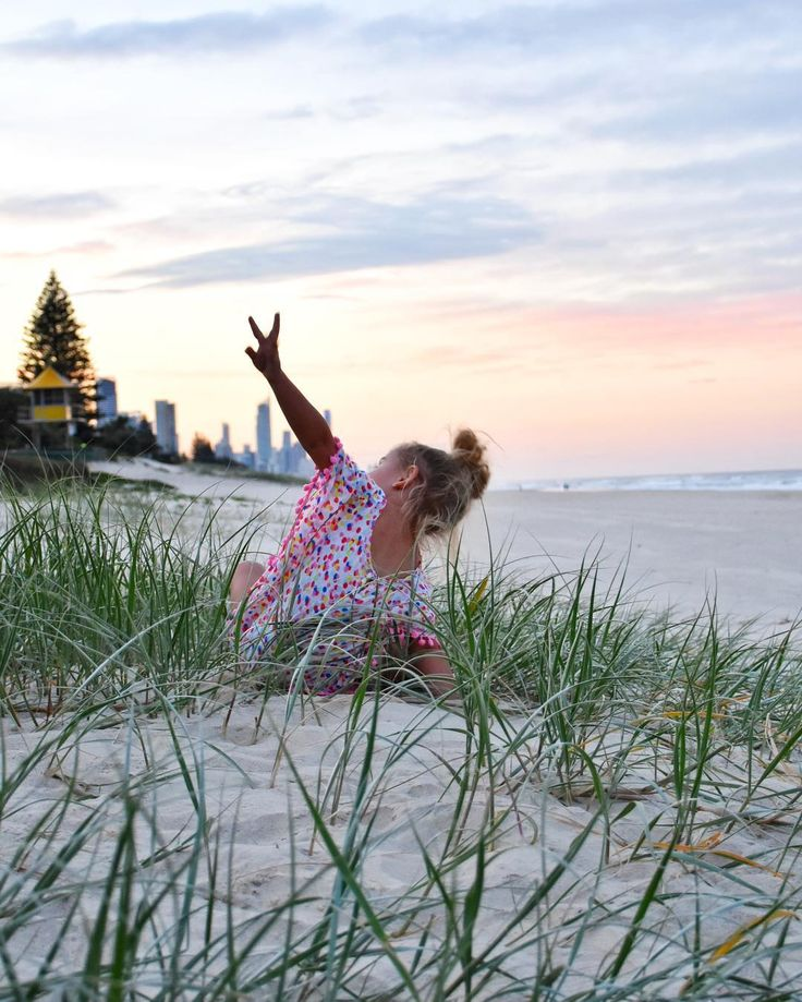 Tiah playing in the dunes at Mermaid Beach by @alittleatlarge