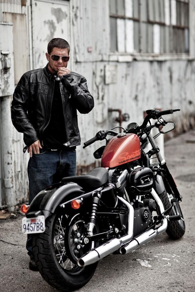 This is the Bomb Runner: a custom Harley built in Taiwan as a sequel to the Iron Guerilla. The base bike is a 2011 Sportster Forty-Eight 1200, but the rear shocks on this bike are a little higher which is what gives it that nice aggressive lean.