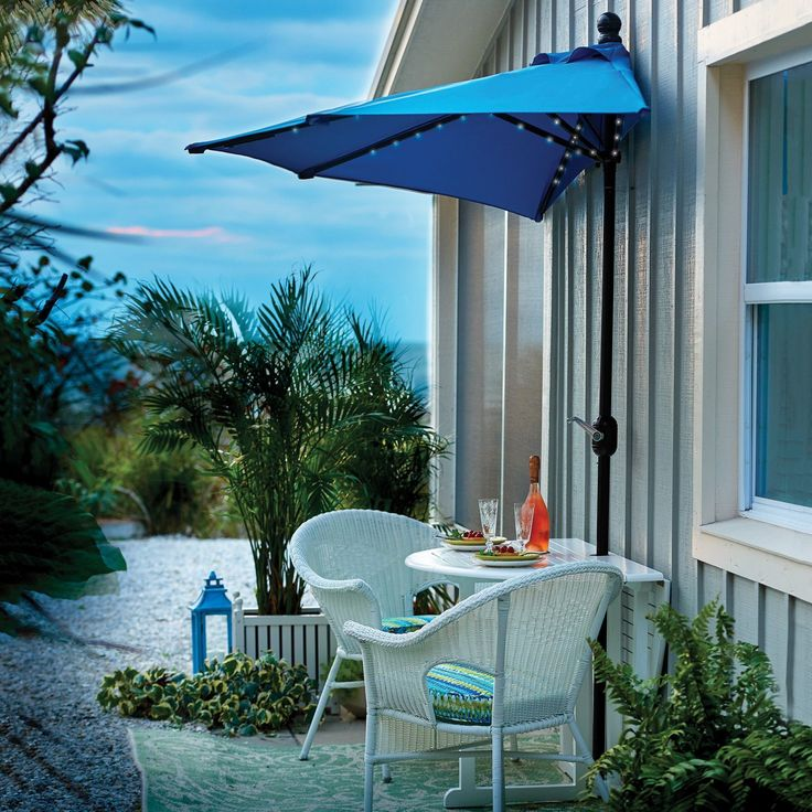 """Looking for small-space solutions for your patio or deck? Our 9' half patio umbrella is right up your alley. Available in 3 colors, it shines brightly with 50 pure white battery-operated LEDs. Patio umbrella is supported by a 1-1/2""""""""Dia. aluminum pole with a corrosion- and weather-resistant brown powder-coated finish and features a crank handle with push-tilt capability. Takes 2 AA batteries and has a convenient on/off switch."""