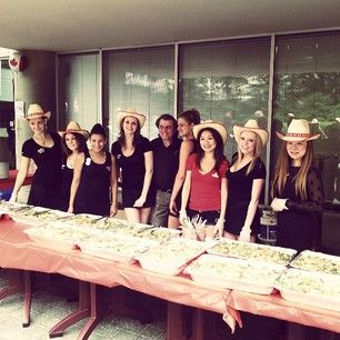 The wonderful staff serving up some great food at our Canada Day Party!