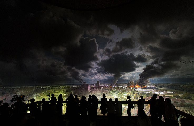 People look at a section of the 360 degree panoramic picture of the historic Battle of the Nations in Leipzig. The monumental picture created by Yadegar Asisi displays scenes from the 1813 battle between Napoleon's retreating army and troops from Austria, Prussia, Russia and Sweden