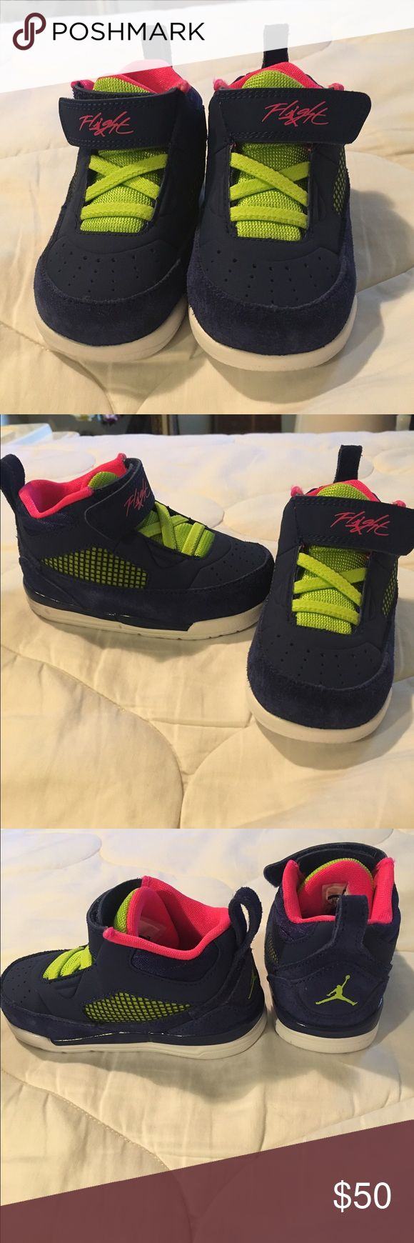 Brand new kids Jordan Flight 9.5 size 6 Brand new shoes from Jordan Flight 9.5 size 6. They are dark blue with accents of pink and green. They have never been worn and come with the box. Jordan Shoes Sneakers