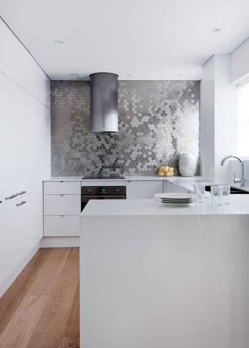 Metal tile splash back with contemporary white cabinetry.  Photo credit- Alloy Solid Metal Tiles