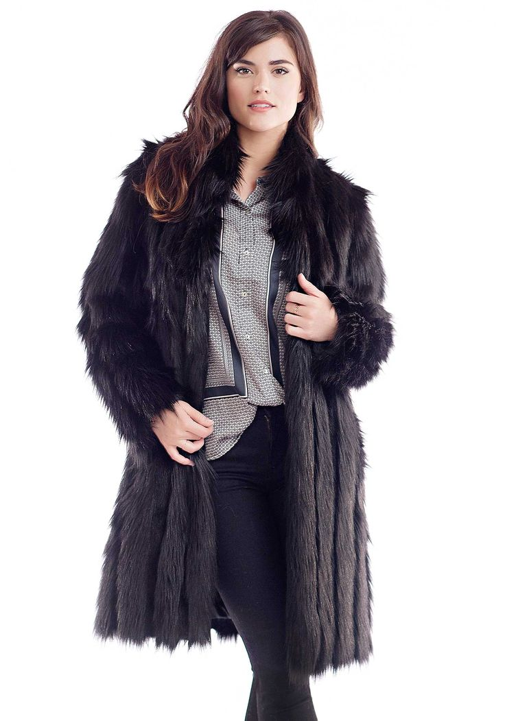 What does a busy, NYC gal wear to business meetings, dinners and Winter walks in Central Park? If you're Cornelia Guest, you'll design a knee-length coat, keeping in mind a busy, big-city life along with weekends in the country. The warmest coat in the socialite/author/designer's capsule collection for Fabulous-Furs, this knee-length coat is designed for style, warmth AND luxury. Lush, plush Black Fox is punctuated with narrow rows of sheared Black Mink, removing any hi...