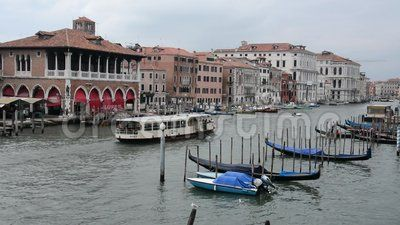 Ferry boats and gondolas passing on Grand Canal in Venice, Italy