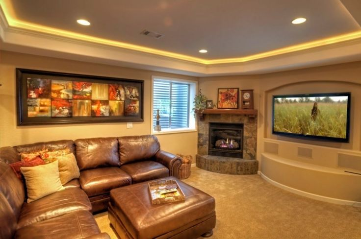 Architecture:Enchanting Basement Finishing Ideas Low Ceiling With Fireplace And Flat Screen Tv Basement Home Theater Design And Pictures Frames Along With Golden Brown Sofas With Cushions And Wooden Floor Also Ceiling Lights The Coolest Basement Finishing Ideas for Your On – going Remodeling Basement