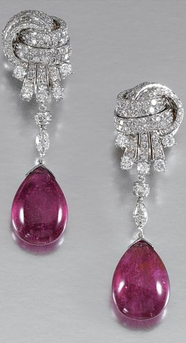 PAIR OF PENDENT RUBELLITE AND DIAMOND EARRINGS Each suspending a cabochon rubellite drop from a marquise-shaped diamond, to a stylised knot surmount set with brilliant-cut stones, post and clip fittings.