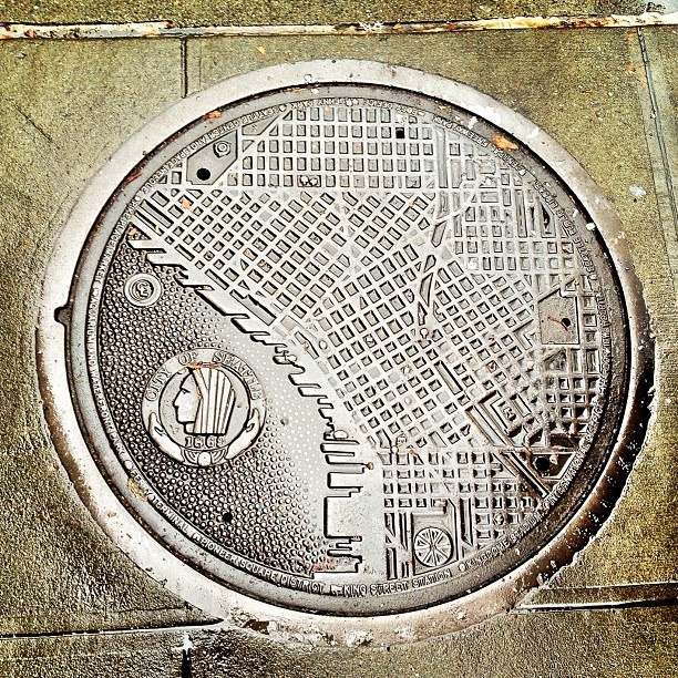 Manhole cover map of downtown.... when Seattle first became incorporated natives were not allowed in the city limits :(