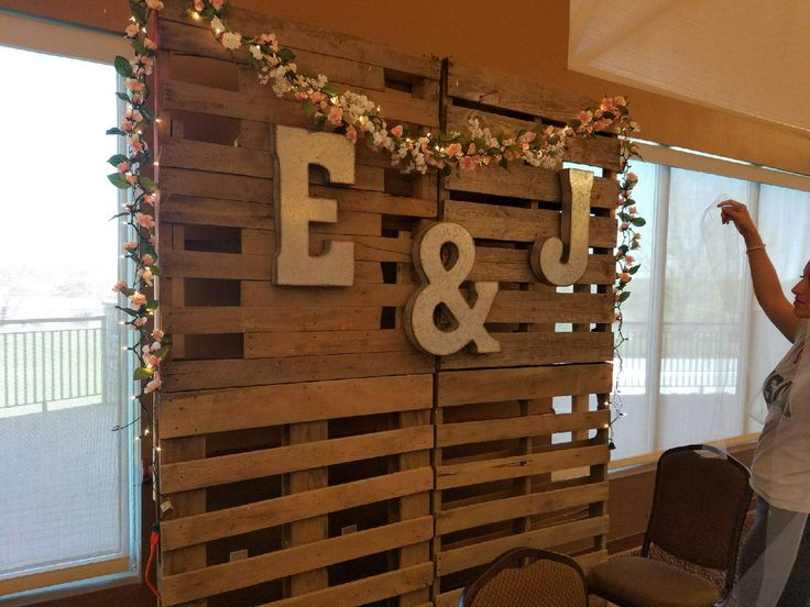 Our beautiful rustic wedding backdrop. Very happy how it turned out! Pallets, Garlands, Metal letters and white lights. That's it! #quickweddingplanning