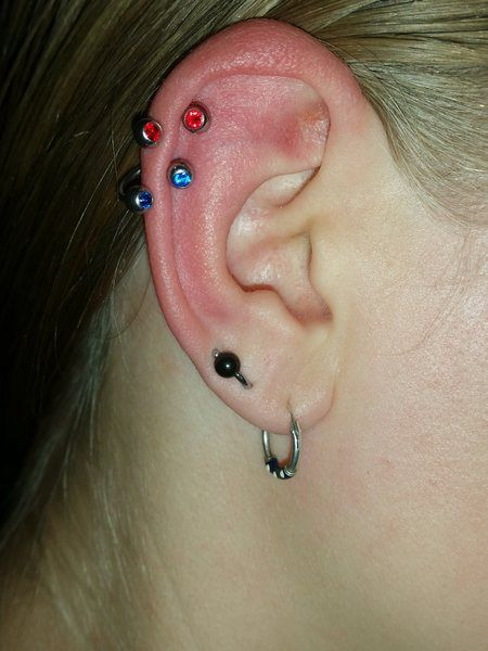 This is my right ear so far, 3 lobes and 2 helixes (but I plan on getting more). Like in the photo I usually have a BCR through my 2nd and 3rd lobe like an orbital piercing. Also, I've never been quite happy with the placement of my 3 lobe piercings in this ear, they're much lower than my left ear, but I've had them for so long and haven't bothered to redo them so I just live with it.