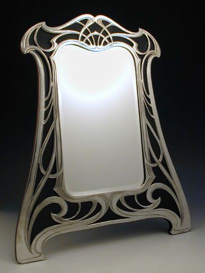 Fabulous art nouveau mirror with polished pewter on a wood back ~ Germany ~1906