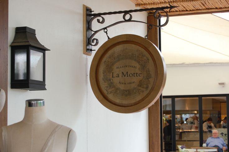 The Plaaswinkel at La Motte Wine Estate.  Wooden sign by Pierre Cronje.
