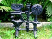 Detta brasskydd eller skulptur i gjutjärn kommer från Husqvarna och är formgivet av Olle Hermansson på 60-talet.