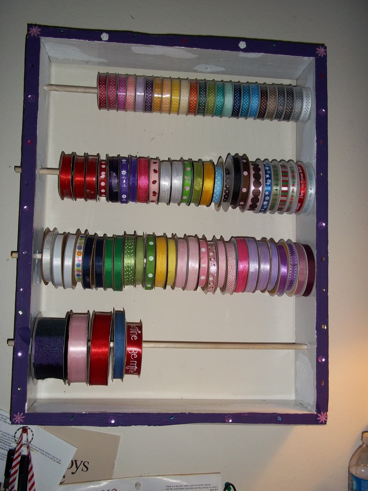 Ribbon rack out of 2 bed slats and wooden dowels made by