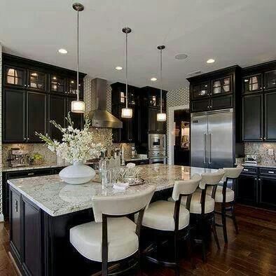 How elegant is this kitchen? BUT the island is still very inviting... sit down and have a cup of coffee with me!