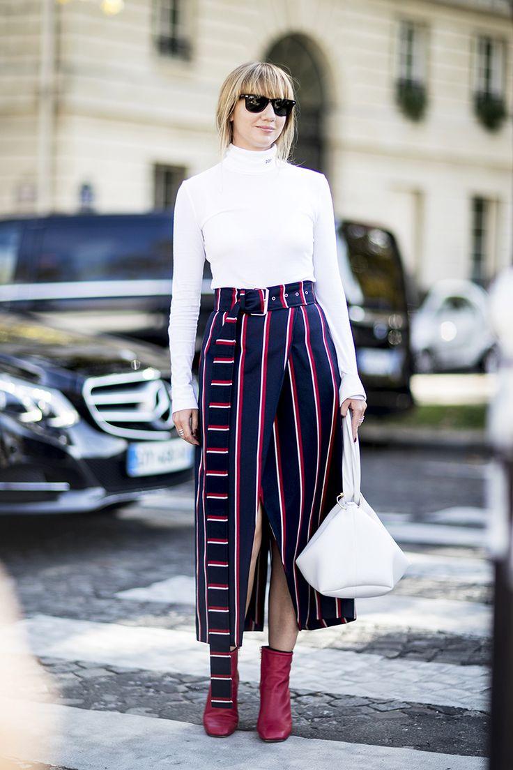 Lisa Aiken In A Calvin Klein Turtleneck, Solace London Skirt, Rag & Bone Boots And A Victoria Beckham Bag
