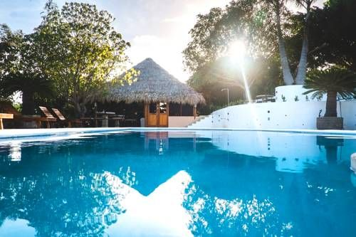 Nicawaves Popoyo Set in Popoyo in the Rivas Region Region, 3.8 km from Salinas, Nicawaves features an outdoor pool and views of the pool. Guests can enjoy the on-site restaurant.