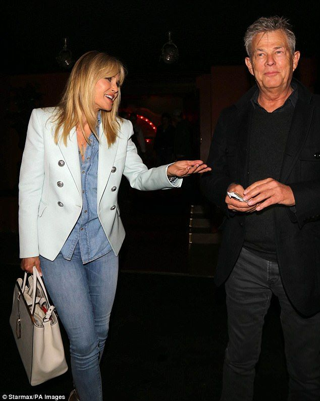 NEVER WOULD HAVE GUESSED THAT WAS KRISTY BRINKLEY. PLASTIC SURGERY IS TOO MUCH.He likes pretty ladies: The grey fox with Christie Brinkley at Craig's in LA in June...