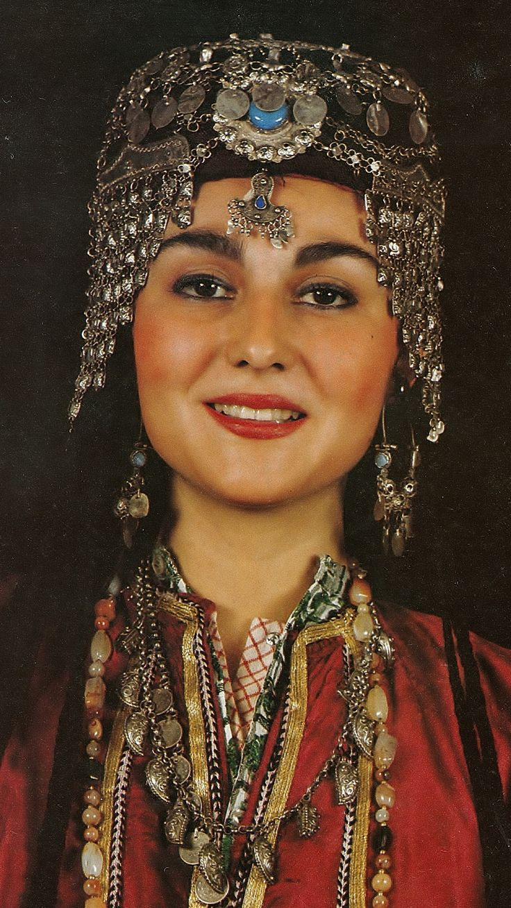 Traditional festive 'gümüş başlık' (silver headgear) from the Urfa region. Mid-20th century. Small silver plaquettes, turquoise, silver 'tepelik' (round cover of the hat), chains, late-Ottoman coins; imitation-hair in 'ibrişim' (thick black silk threads). (Source: 'Tarihi Türk Kadın Kıyafetleri', Istanbul 1986).