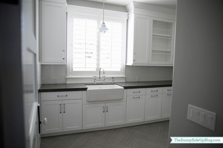 Laundry room of my dreams! Really not sure what my favorite feature is...pull out hampers, fold down drying rack, farmhouse sink....oh my!