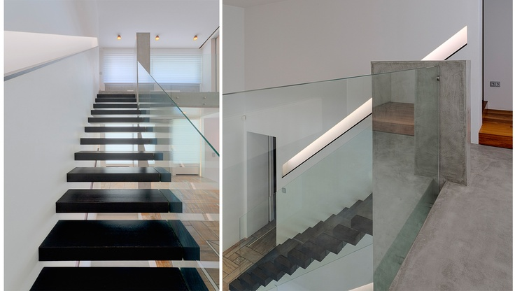 Design Lobby | Portfolio - Members-Bllend A Staircase connecting Living and Sleeping quarters of an Urban Luxury Villa.  A glass panel has been conceptualized as a blade cutting vertically the cantilevered dark wooden steps.