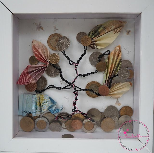 Moneytree made from old coins leftover from travels