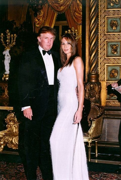 Portrait Of American Businessman Donald Trump And Model Melania Knauss As They Pose Together At The MaraLago Estate Palm Beach Florida 1999