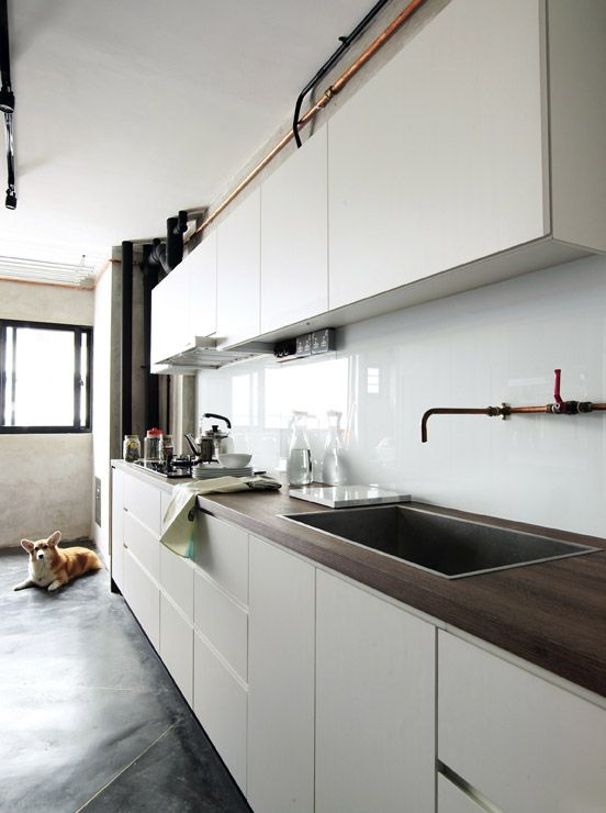 handle-free kitchen cabinets complement the solid white glass