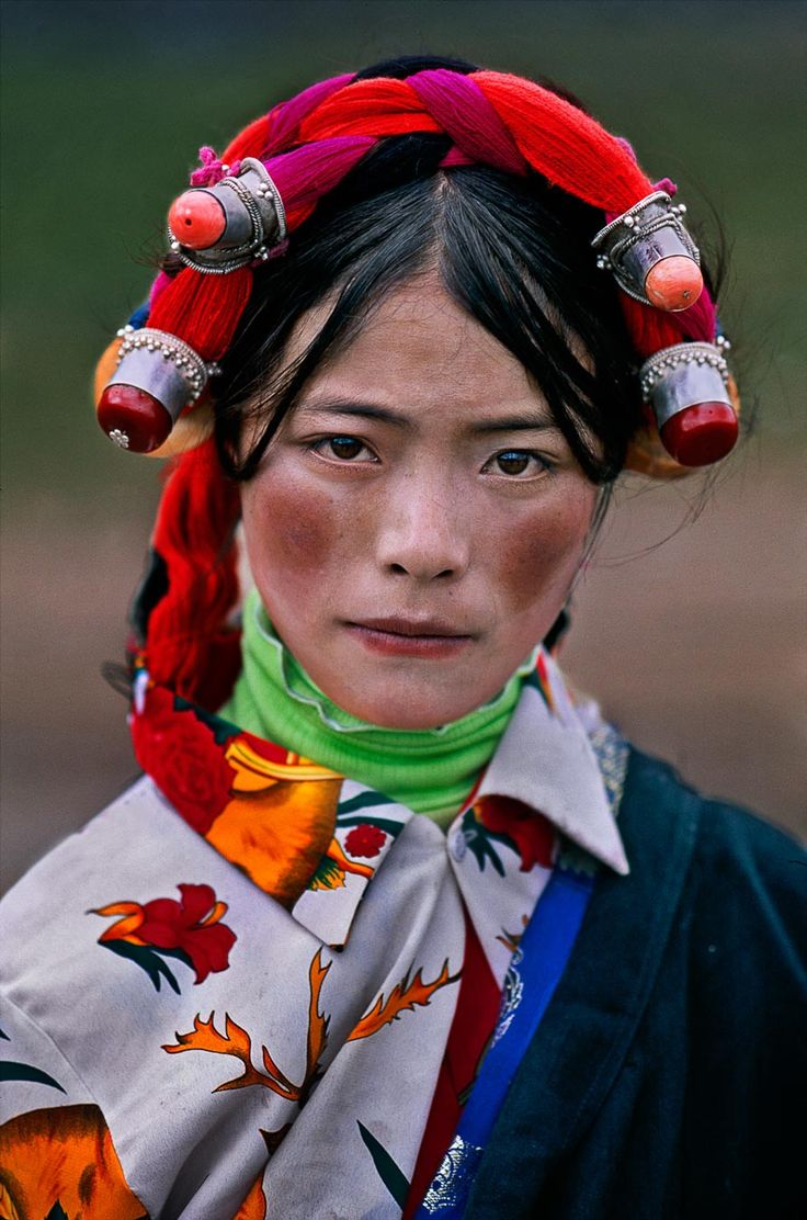 Asia | Portrait of a young Woman wearing a traditional headdress, Tagong, Tibet | © Steve McCurry