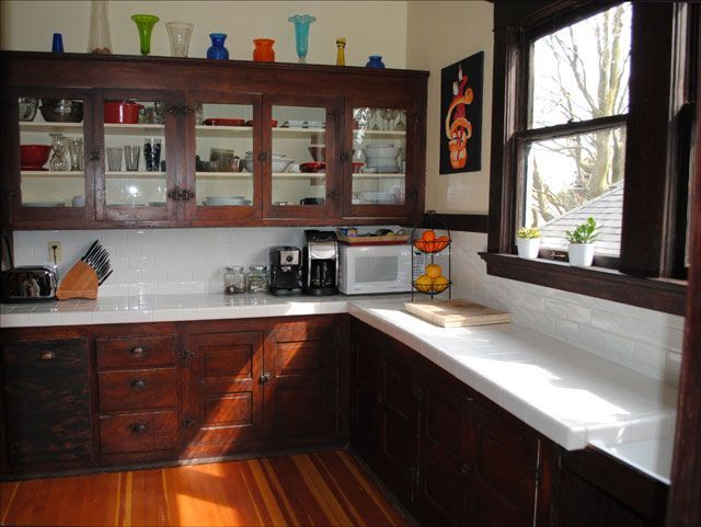 1912 Craftsman Kitchen - the combination of using doors to match the rest of the house, wood floors, and  wood tone cabinets and the light countertops....  and the hardware!