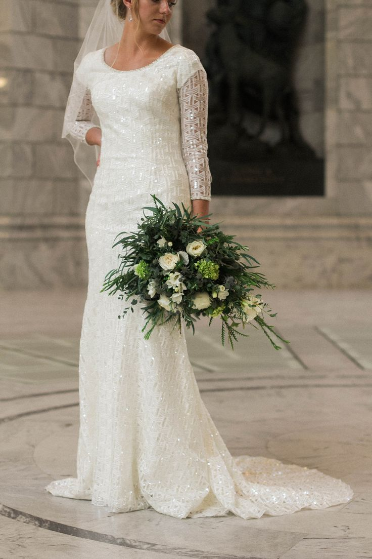 Modest Wedding Dresses Magazine : Modest wedding dress with long sleeves and a tight skirt