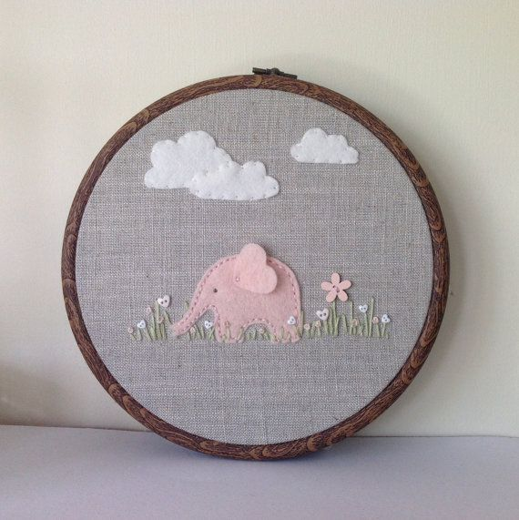 Pink elephant nursery hoop art can be by BoxRoomBazaar on Etsy, £16.50