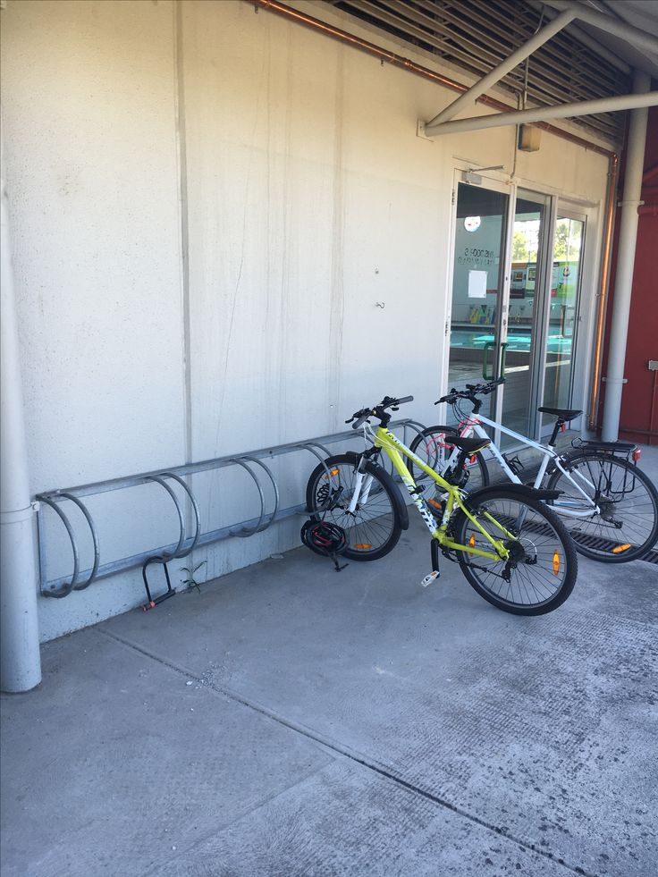 Physical environment: facilities. Bike racks at school encourage people to engage in active transport to and from school instead of taking public transport or car.