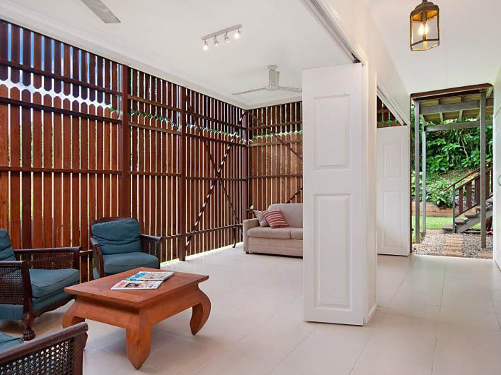 What a clever idea: utilising a zone under a buildin of a queenslander with traditional timber slat appication as an outdoor area - VERY Far North QLD! KWD Cairns Renovation Consultancy - Before & After