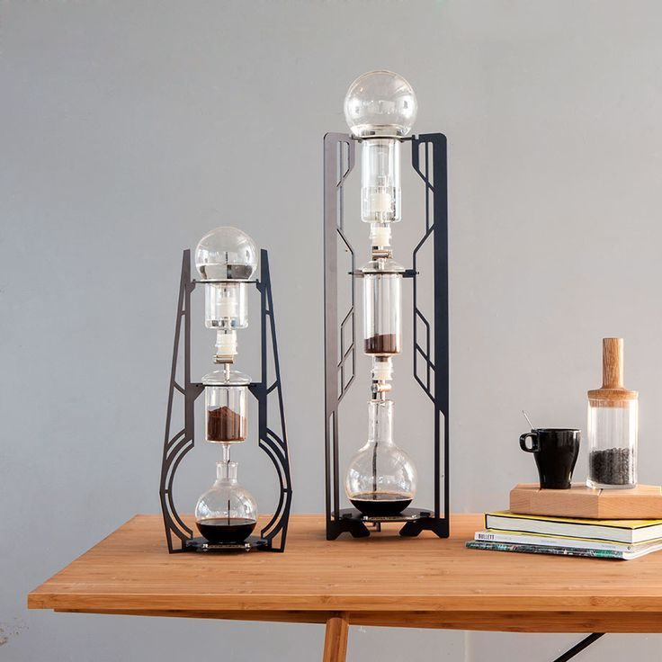 Elegant Slow-Brew Coffee Makers - by Dutch Lab developed this idea to cut down the time needed for slow-brewed coffee, use cold water for less acidic results, and remove the need for electricity—and their innovative experimentation has been a success: each Dutch Lab machine has three vertically aligned glass flasks that the water drips through to make aromatic coffee.