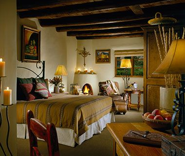 """La Posada de Santa Fe Resort & Spa, NM  Rooms here embrace the Southwest, from works by local artists to the traditional kiva fireplaces—adobe beehive-style, with a distinct arched firebox door. The resort offers other warming inducements as well, such as """"Handcrafted Winter Warmers"""" cocktails at the Staab House bar and Mexican Chocolate Chili Wrap treatments at the spa."""