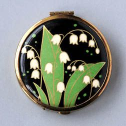 Selfridge 1920s-30s. Small goldtone pressed powder compact made for Selfridge's range of face powder. These slightly stylised flowers fit in with the Art Deco imagery prevalent at the time.