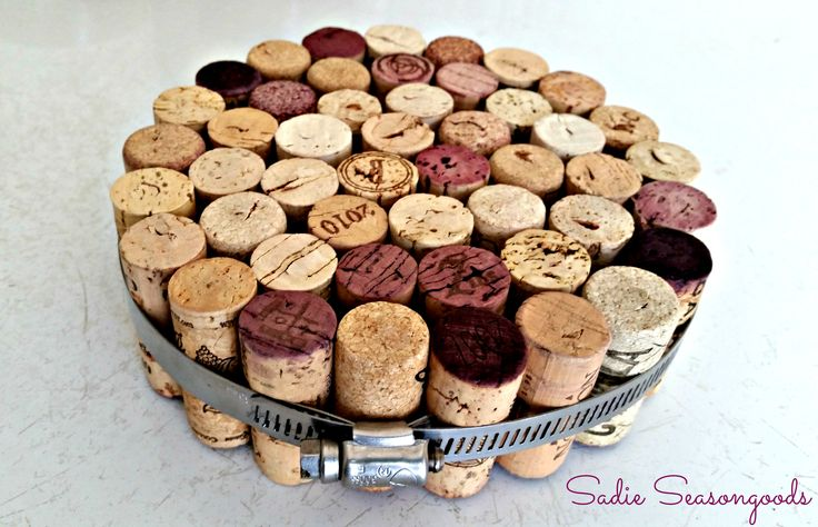 Wine corks (and we all have TONS of those) make for a super easy trivet by wrapping them in a hose clamp (for an industrial look) or an embroidery hoop (for a more classic look). I use this all the time- love this upcycle / repurpose project! #sadieseasongoods