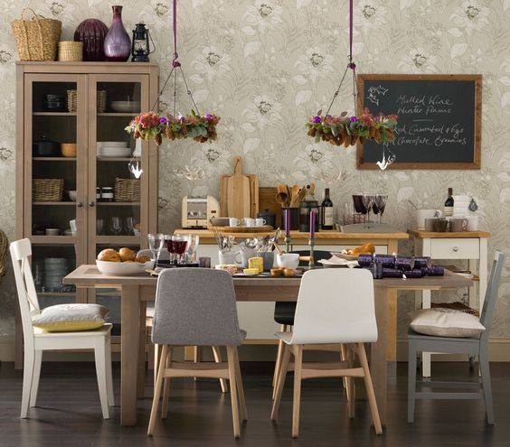 Mismatched chairs in a range of neutral shades make this dining room feel relaxed and inviting.