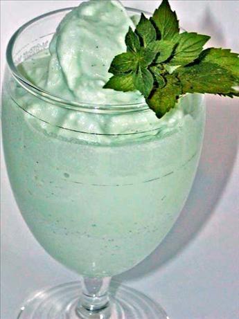 Frozen Grasshopper (3/4 oz creme de menthe, green 3/4 oz white Creme de Cacao 2 cups vanilla ice cream 4 ice cubes fresh mint leaves)