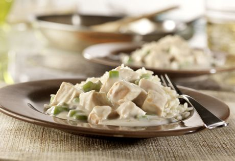 This creamy chicken with diced green or red peppers makes a perfect topping for rice or potatoes, and is a family favorite.