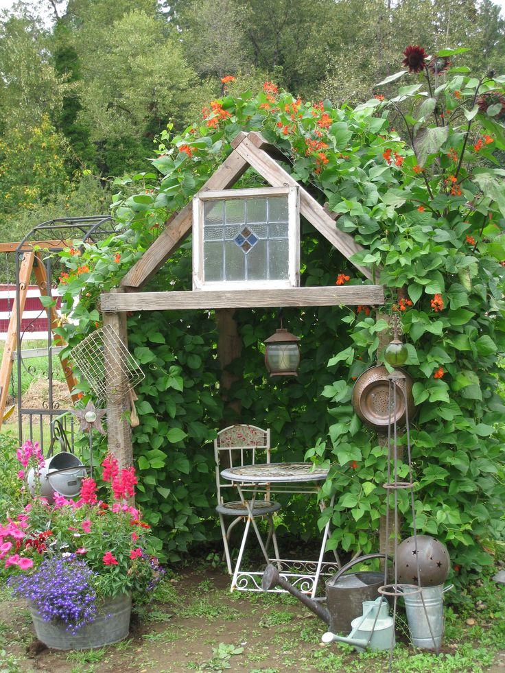 My Bean House.  We built a primitive frame, covered with chicken wire and let Scarlet Runner Beans take over!  Scarlet Runners are a delicious french green bean, whose vines grow up to 20 feet long!  They also boast a beautiful scarlet bloom that attracts hummingbirds.  My favorite place in the garden!    I think I want this in the back corner of the yard!