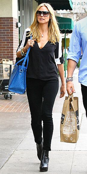 HEIDI KLUM  Following her short Tweet since splitting from Seal, Heidi makes a graphic statement, shaking up her black ensemble with a white streaked top and standout blue tote during a Whole Foods pit stop in Brentwood, Calif.