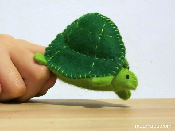 This is a sewing pattern for a turtle/tortoise finger puppet, which can also be used as a cute decorative piece.  The finished turtle/tortoise is