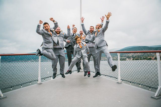 Jump! Groomsmen on the bow -  Photo by Justine Russo
