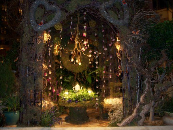 Fairy Tea Party idea. Love the hanging petals on fishing wire. Could hang white Christmas lights, too. So magical!