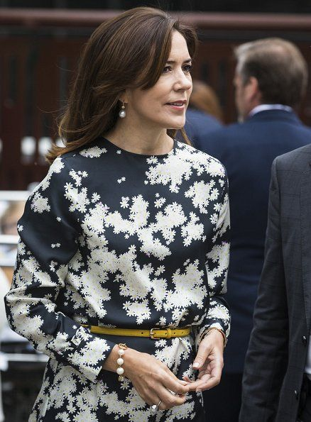 Crown Princess Mary of Denmark offset her look with pearl earrings and a matching pearl bracelet for the day.