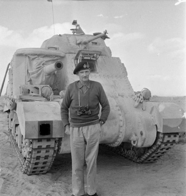 Lt General Bernard Montgomery, GOC 8th Army, standing in front of his personal Grant tank, 5 November 1942. He had commanded the first major victory against the Germans and was about to become world famous.
