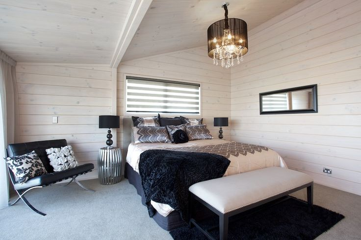 Main bedroom with extension in The Stewart show home in Taupo.  Modern blonded wood interiors